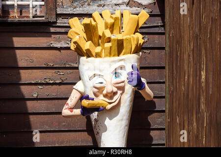 Milan , Italy 17 July 2018 : an abandoned statue that represents the advertising of a fries shop . French fries mascots are the favorite side dish and - Stock Image