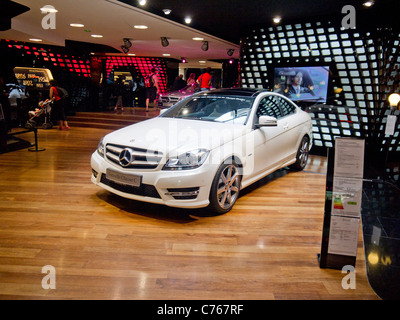 White Mercedes car In Paris showroom - Stock Image