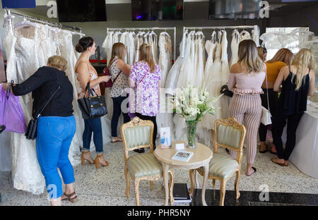 Women shopping for wedding dresses at a Wedding Fair, Newmarket, Suffolk UK - Stock Image
