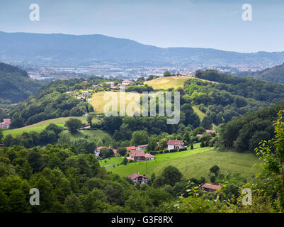 Fields and Pyrenees mountains in the Pays Basque, France - Stock Image