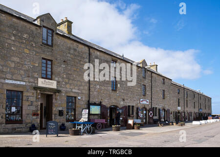 Gift shop, Fisheries and Community museum and cafe in renovated old buildings on Pitgaveny Quay, Lossiemouth, Moray, Scotland, UK, Britain - Stock Image