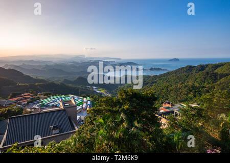 Beautiful sunset over the ocean coastline of Taiwan seen from Jiufen village, Taipei. - Stock Image