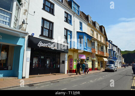 Shops on a street in Ilfracombe, Devon, UK - Stock Image