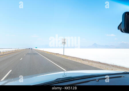 Highway Speed Limit 80 mph sign on the I-80 West through Bonneville Salt Flats near Wendover Utah. - Stock Image