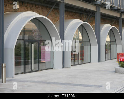Three of the thirteen renovated Wood Lane railway arches almost ready to let, all part of phase two of the extended Westfield, White City, London - Stock Image