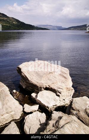 rocks on Scottish loch - Stock Image