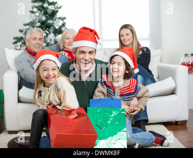Happy Family With Gifts During Christmas - Stock Image