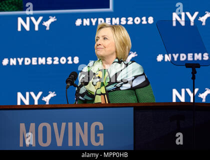Long Island, USA. 23rd May, 2018. HILLARY CLINTON, with lips pursed, delivers Keynote Address during Day 1 of New York State Democratic Convention, held at Hofstra University on Long Island. Clinton, the former First Lady and NYS Senator, endorsed the re-election of Gov. A. Cuomo for a third term, and mentioned how Hofstra was the site of her first 2016 debate with Trump. Credit: Ann E Parry/Alamy Live News - Stock Image