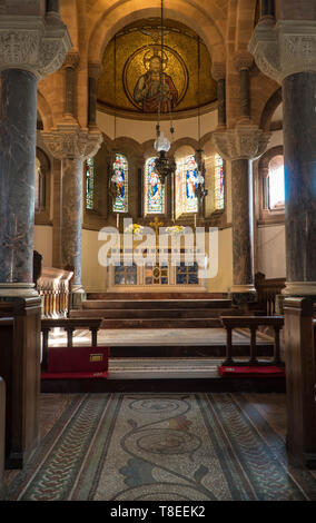 St. Catherine  church Hoarwithy, four central marble pillars line the way to the alter and apse Hereford England UK. February 2019. - Stock Image