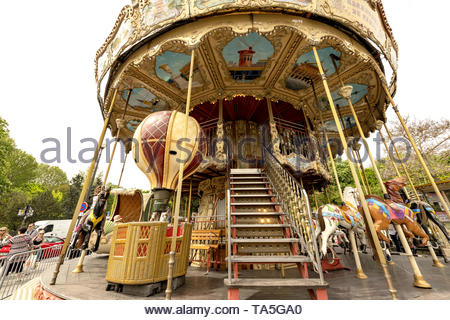 Shot of classic style colorful spinning merry-go-round in Paris, France.  Avenue Gustave V de Suède, just next to the Warsaw Fountains and in front of - Stock Image