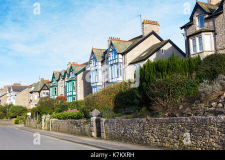 Houses dating from the Victorian period on the Promenade at Arnside, Cumbria. These large houses are now mostly divided into flats. - Stock Image