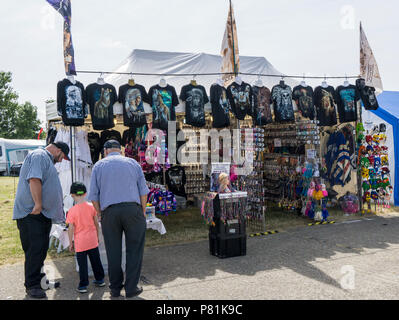 People looking at goods on clothing stall at Wings and Wheels - Stock Image