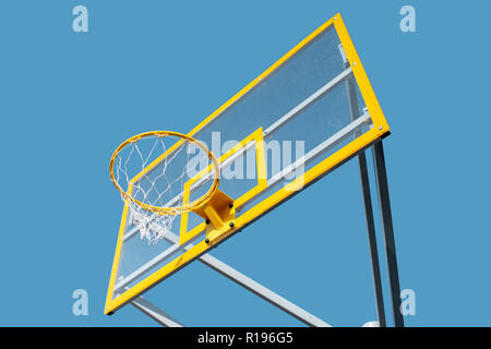 Close-up of a new basketball ring on the blue sky background - Stock Image