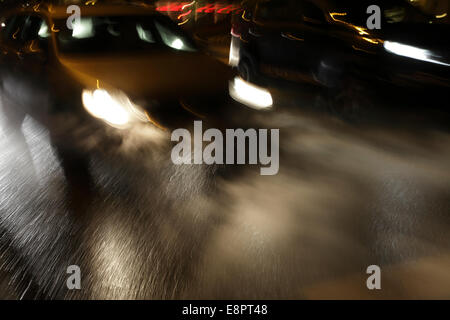 Cars driving on an ice-covered street, blurred. - Stock Image