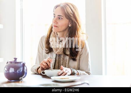 Woman having tea. - Stock Image