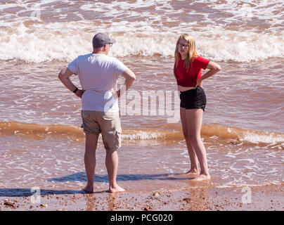 Sidmouth, 2nd Aug 18 Visitors enjoy the sun on Sidmouth beach Photo Central/Alamy Live News - Stock Image