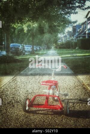 Tricycle on sidewalk. - Stock Image