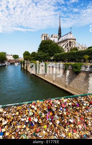 Love Locks along Pont de l'Archevêché below Cathedral Notre Dame, Paris France along river Seine - Stock Image