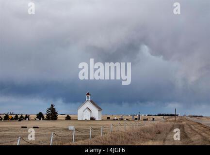 Prairie Storm Clouds in Saskatchewan Canada Country Church - Stock Image