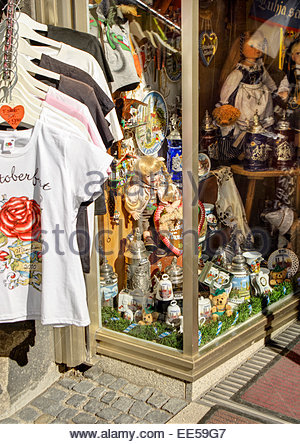 Steins, dolls, T-shirts and other souvenirs of Oktoberfest are on offer in a Munich shop window. - Stock Image