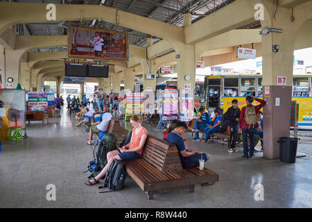 Passengers await in the departure area of  Kanchanaburi central bus terminal, in Thailand. - Stock Image