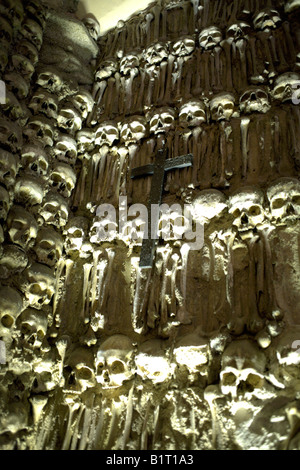 Wall decorated with human remains and a cross in the Chapel of Bones,  Church of St Francis,  Evora, Alentejo, Portugal, - Stock Image