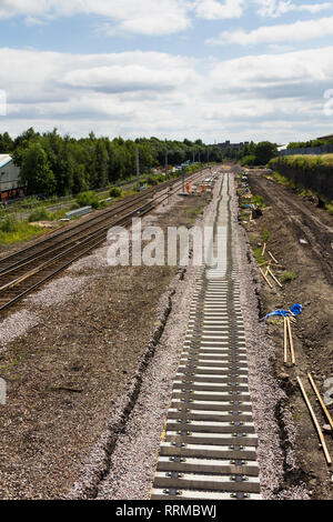 New railway track being laid at Bolton on the Preston to Manchester railway line  as part of the route's electrification and modernisation programme. - Stock Image