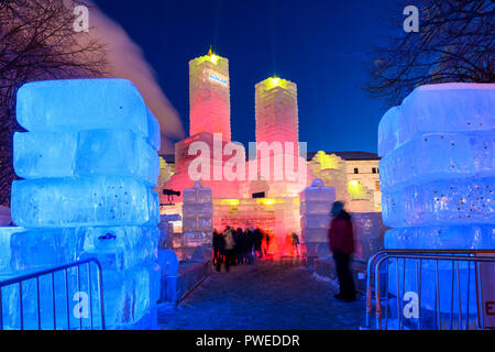 2018 Saint Paul Winter Carnival Ice Palace with red and yellow lighting. The ice palace was built in Rice Park downtown St. Paul, Minnesota. - Stock Image