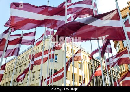 Latvian flags flying in Riga, Latvia - Stock Image