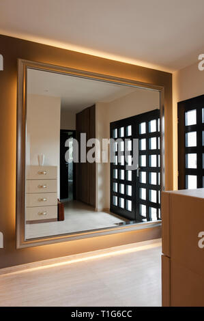 Mirror in modern entrance hall - Stock Image