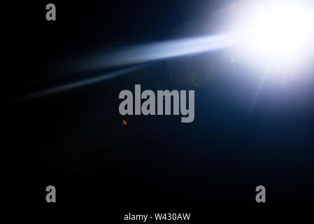 Flash of a distant abstract star. Abstract sun flare. The lens flare is subject to digital correction. - Image - Stock Image