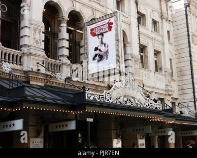 The Noel Coward theatre in London's West end with signage for the play 'The leiutenant of Inishmore' starring Aidan Turner - Stock Image