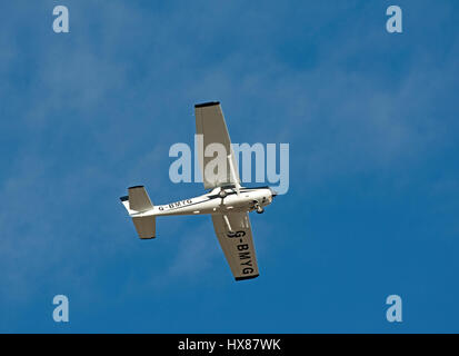 Fine weather flying at Inverness, Dalcross Airport in this Cessna FA 152 IN Scotland UK. - Stock Image