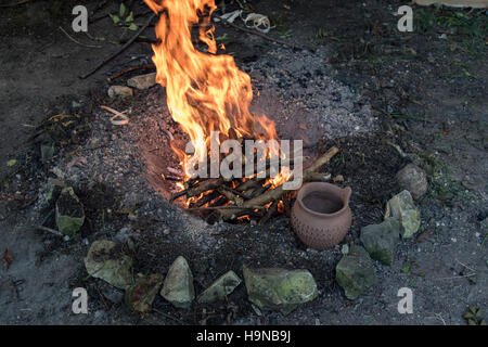 Wood fire with hand made pottery - Stock Image