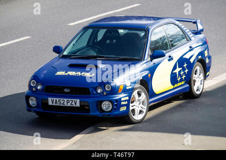 A classic 2012 Blue and Yellow Subaru WRX sports car in  North Yorkshire England UK - Stock Image