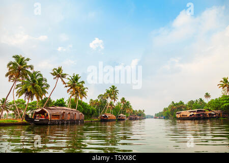 A houseboat sailing in Alappuzha backwaters in Kerala state in India - Stock Image