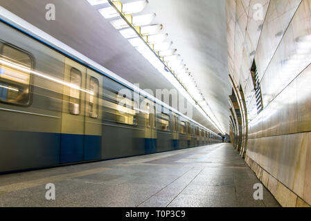 Subway metro train arriving at a station. Motion blurr effect - Stock Image