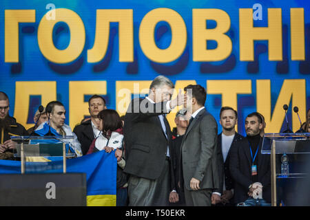 Kiev, Kiev, Ukraine. 19th Apr, 2019. Tension in the debate between the candidates for the Presidency of Ukraine, Petro Poroshenko, left, and Volodymyr Zelenskiy, right under arm, at the Olympic National Sports Stadium in Kiev.Tension Credit: Celestino Arce Lavin/ZUMA Wire/Alamy Live News - Stock Image