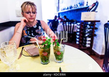 Drinking Mojito, Drinking Mojitos, Mojito, Mojitos, mojito drinks, rum based drink, rum based drinks, Cuban drink, - Stock Image