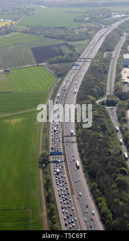 portrait aerial view of static stationary traffic on the M6 looking south at Warrington towards junction21 in the distance - Stock Image