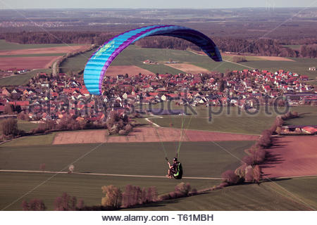 Paraglider many people are fascinated by flying - Stock Image