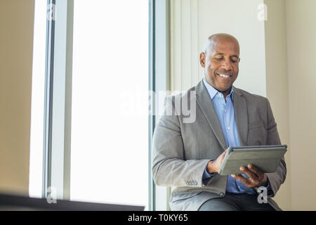 Portrait of an African American man at work. - Stock Image
