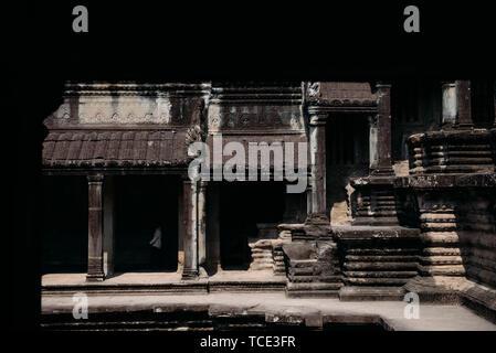 Man walking amongst Temple ruins, Angkor Wat, Siem Reap, Cambodia - Stock Image