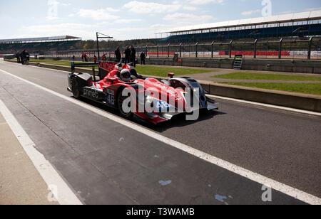 A Red, 2012, Oreca 03 LMP2, driven by Mark Higson,  in the Pit Lane at the 2019 Silverstone Classic Media/Test Day - Stock Image