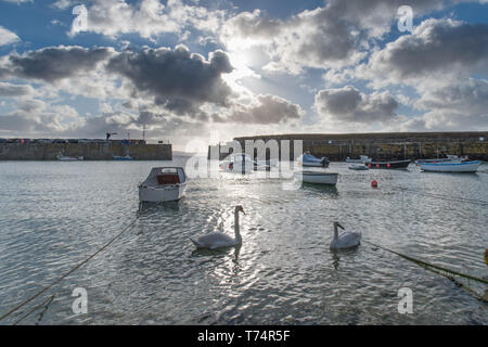 Mousehole, Cornwall, UK. 4th May 2019. UK Weather. Fast moving clouds meant the sun kept breaking through this morning, with holiday makers looking forward to a fine bank holiday  in Cornwall. Credit Simon Maycock / Alamy Live News. - Stock Image