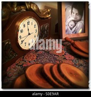 Vintage clock with photo of mother and child - Stock Image