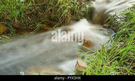 Long exposure of water rushing through a creek on Kangaroo Island in South Australia, Australia. - Stock Image