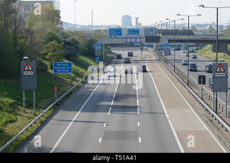 Traffic leading towards Heathrow airport during a sunny bank holiday in the UK. - Stock Image