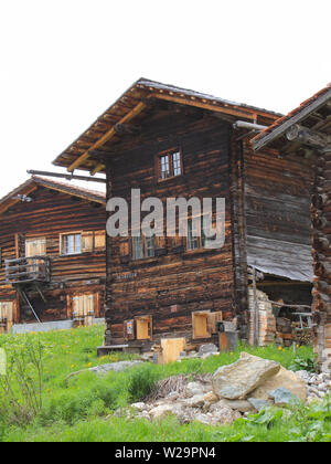 Old timber houses in Obermutten, Canton of Grisons, Switzerland. - Stock Image