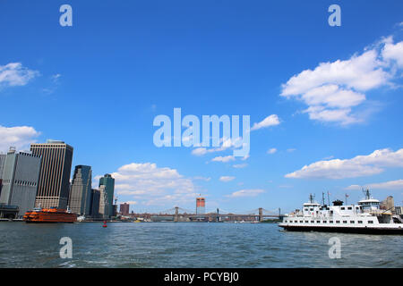 Iconic Staten Island Ferry leaving Manhattan and Governors Island ferry boat, Manhattan on JULY 4th, 2017 in New York, USA. (Photo by Wojciech Migda) - Stock Image